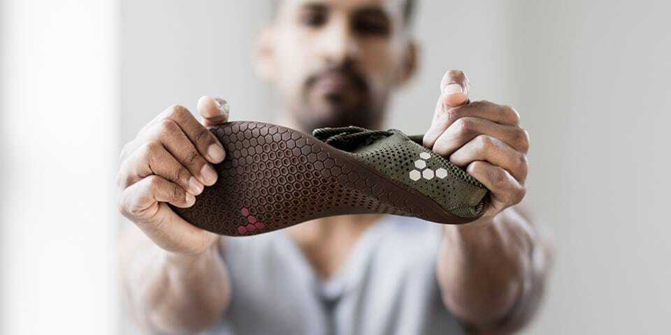 Photo from: https://www.businessinsider.com/barefoot-shoes-vivobarefoot-review-2018-4?r=US&IR=T showing the flexibility of a minimalist shoe